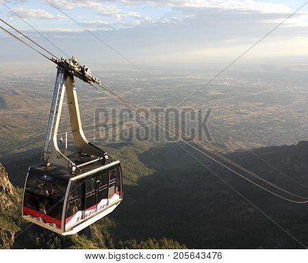 ALBUQUERQUE, NEW MEXICO, JUNE 18. The Sandia Peak Aerial Tramway Observation Deck on June 18, 2017, in Albuquerque, New Mexico. A Sandia Peak Aerial Tramway Downhill Tramcar Seen from the Observation Deck in Albuquerque New Mexico.