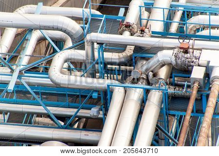 Industrial concept. Liquid gas container. Gas storage in the port. Pipelines in the refinery