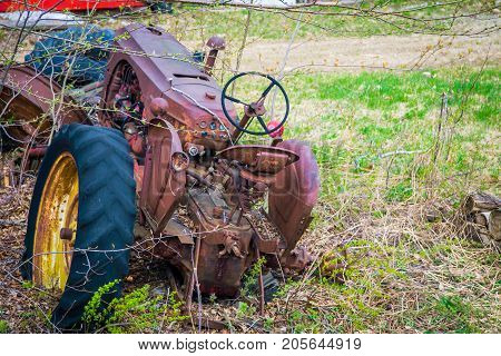 Old broken down rusted abandon tractor in new Brunswick