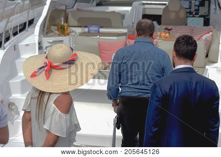 Hostess waiting for boarding on a luxury yacht
