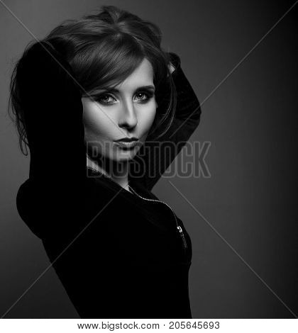 Beautiful Sexy Makeup Woman With Blue Eyes In Fashion Black Clothing Looking Mystic And Calm On Dark