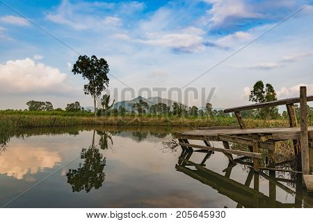 Beautiful Mirror Reflection Lake And Old Wooden Fishing Jetty In Nam Sang Wai, Yuen Long, New Territ