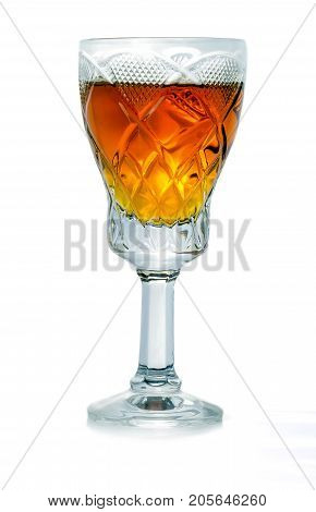 elegant glass filled with fragrant brandy on a white background