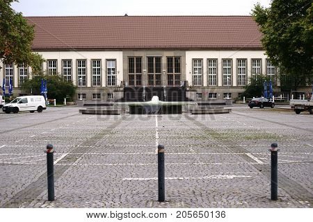 MAINZ, GERMANY - OCTOBER 24: The Hans Klenk Fountain on the grounds of the Johannes Gutenberg University in front of the Aula on October 24, 2017 in Mainz.
