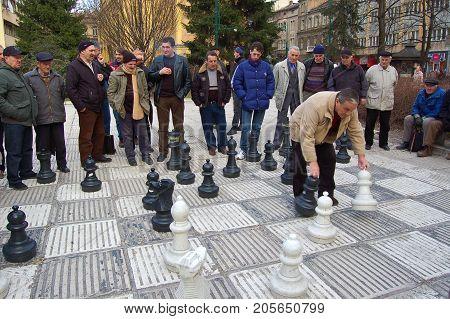 23 march 2009-sarajevo-bosnia-men playing giant chess in sarajevo
