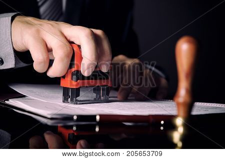 Lawyer Or Attorney Working In Office With Automatic Stamp