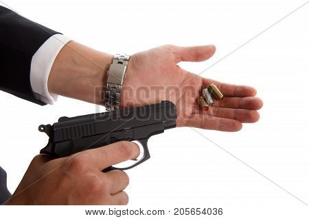 Gun with patrons in man hand on white background