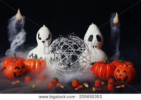 Halloween Candy Corns With Pumpkins And Spiders In Smoke