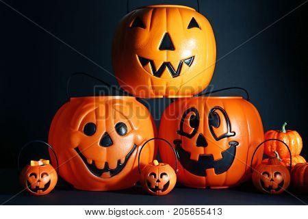 Orange halloween baskets on the black background