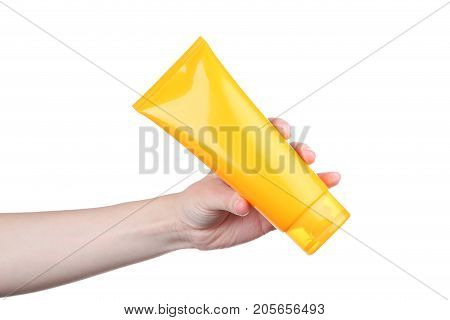 Female Hand Holding Sunscreen Cream On White Background