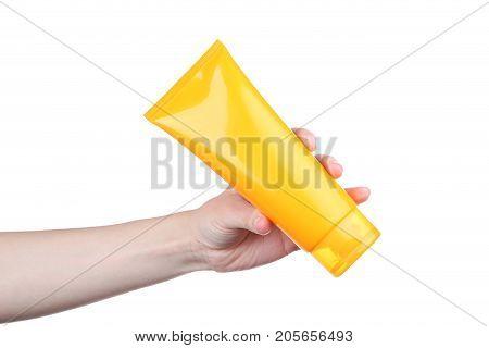 Female Hand Holding Sunscreen Cream On White Background
