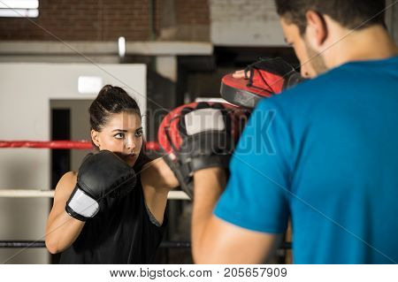 Woman Training With Boxing Mitts
