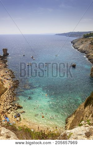 Summer seascape, Apulia coast: Salento beach: Miggiano bay. It's characterized by a alternation of sandy coves and jagged cliffs overlooking a truly clear and crystalline sea.
