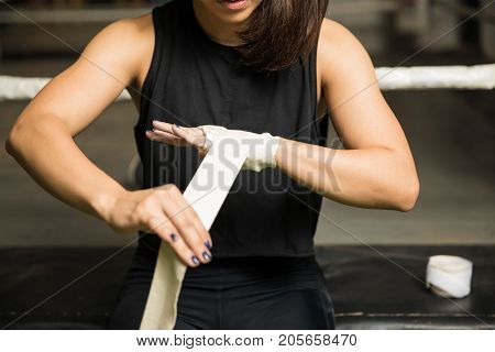 Boxer Wrapping Her Hands