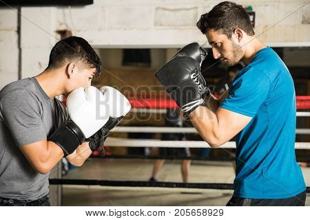 Shorter Man Fighting A Taller Opponent