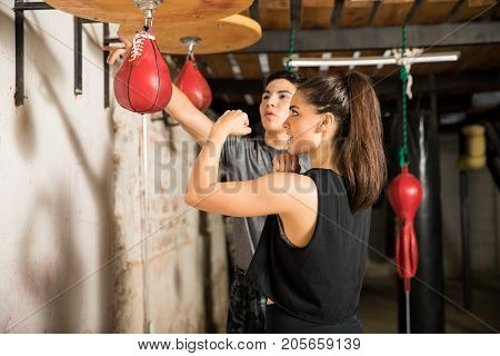 Woman Using A Speed Bag For Training