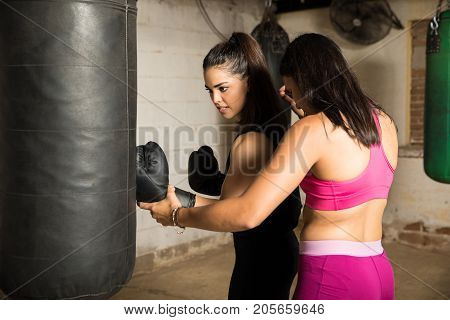 Female Boxer With Her Coach