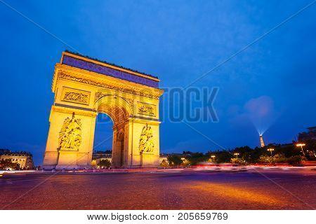Scenic view of the illuminated Arc de Triomphe at night, Paris, France