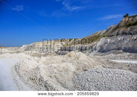 Quarry white stones for construction, limestone mining landscape