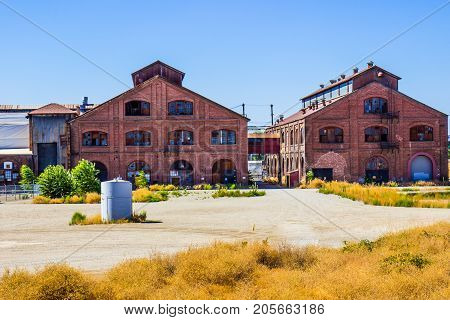 Two Vintage Multi Story Brick Buildings At Railroad Maintenance Yard