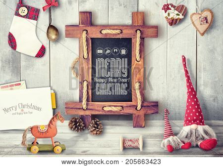 Merry Christmas Greeting Card with Xmas Elements on Wooden Background. Retro Style.