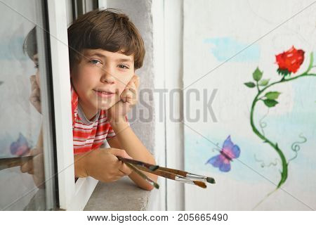 Preteen  Artist Boy With Brush And His Painting