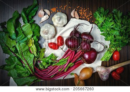 beets on the table, along with vegetables, onions, tomatoes garlic