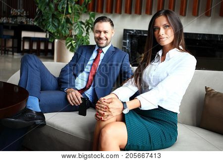 Professional male and female business partners having meeting to discuss planning strategy for common startup project thinking about attracting investors and sponsors to increase cash budget.