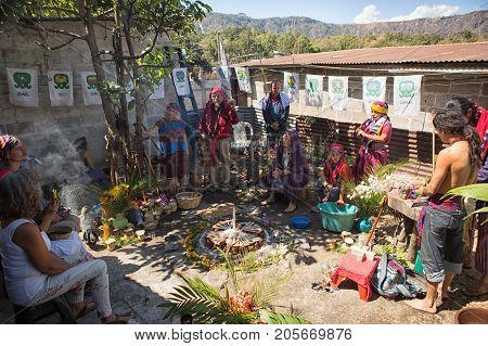 January 31 2015 San Pedro la Laguna Guatemala: people gathering around a fire set of candles performing shamanic ritual with tata Pedro Cruz one of the last authentic shamans
