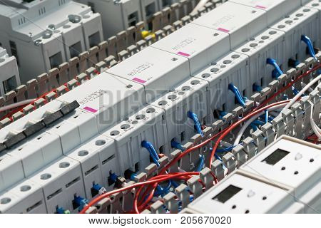 A series of modular magnetic contactors and a range of power circuit breakers. Between the rows of contactors and switches and devices perforated cable channels. They laid the electrical wire.