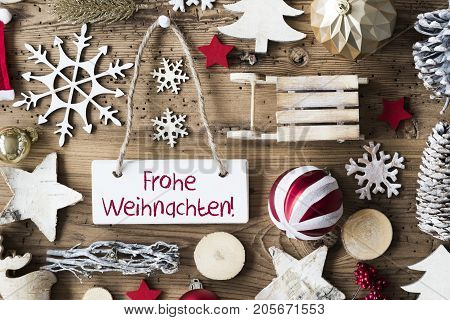 Signboard With German Text Frohe Weihnachten Means Merry Christmas. Christmas Decoration Like Sled, Ball, Christmas Tree And Snowflake. Brown Rustic Woodn Background. Natural Style