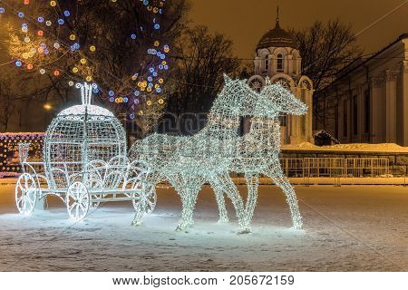 Belgorod Russia - January 8 2017: LED light horses with a carriage decoration composition in New Year's Cathedral Square Belgorod city.