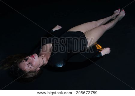 Young Woman Lying In A Water