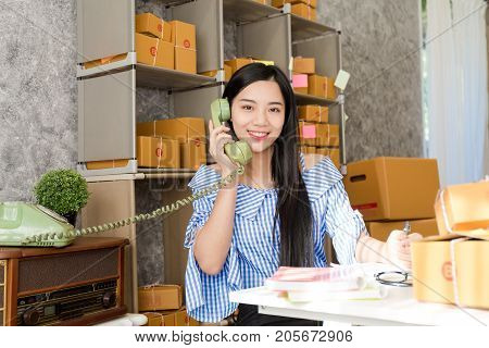 Asian woman with product packaging work at home concept small and medium-sized enterprises (SMEs) concept.