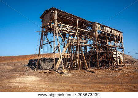 Abandoned wooden machinery building of salt mine Salinas. Cape Verde Africa