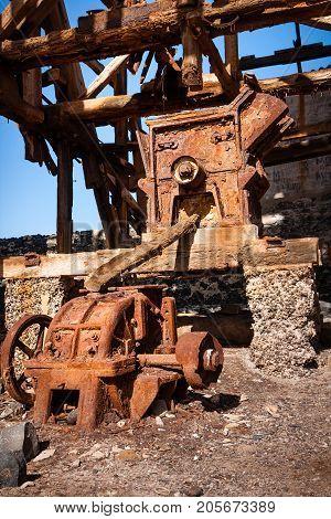 Rusty machine in salt transportation cableway. Pedra de Lume. Cape Verde