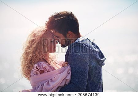 tender couple in love hugging together on sea background