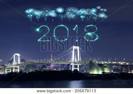 2018 happy new year firework sparkle with rainbow bridge tokyo cityscape japan