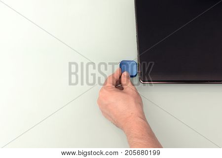 Usb Blue Flash Drive On Hand With Notebook Computer