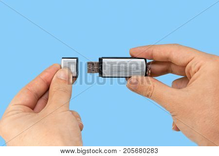 Metal Memory Stick On Hand With Blue Background