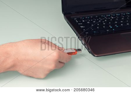 Usb Memory Stick On Hand With Notebook Computer