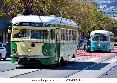 September 19, 2017 in San Francisco, CA:  Railway Street Cars which are refurbished railway cars from the early 1900s taken on Market Street in San Francisco, CA where passengers can ride these cars between the Castro District and Fisherman's Warf