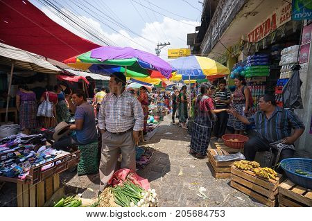 April 17 2016 San Pedro la Laguna Guatemala: sturdays the main street of the indigenous town fills up with vendors and buyers during the weekly farmers market