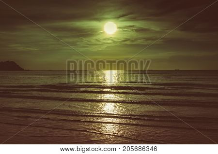 Colorful Sky With Cloud And Bright Full Moon Over Seascape.