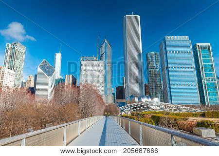 Chicago - March 2017, IL, USA: View of skyscrapers and office buildings in downtown Chicago. Nichols Bridgeway in Millennium Park