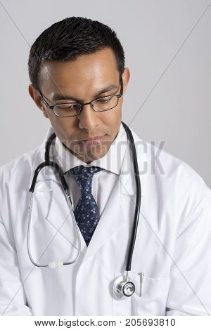 Medical Practitioner In Uniform With Stethoscope Around Neck