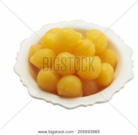 Isolated and clipping path of egg yoke fudge balls cooked in syrup.