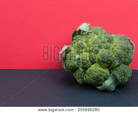 Green Organic Cauiliflower On Coloured Background