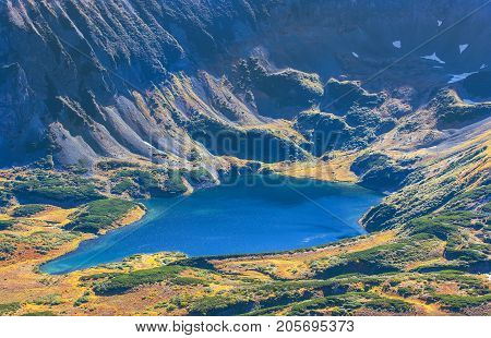 Blue lake in the crater of an extinct volcano in Kamchatka