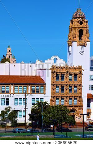 September 19, 2017 in San Francisco, CA:  Mission High School Campus with its Spanish architectural design and large dome tower built in 1927 taken at the Mission District where kids can attend a public school amongst elegant Spanish architecture